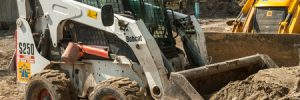 Bobcat machine with bent glass windshield