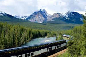 train in canadian rockies with curved glass